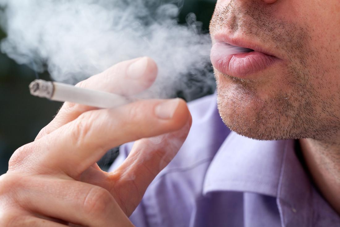 [closeup of a man smoking]